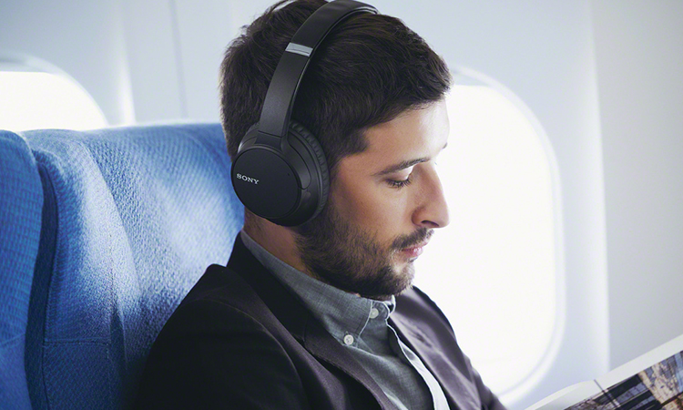 A Guy Listening to Headphone